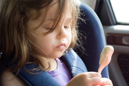 girl eating ice cream in car